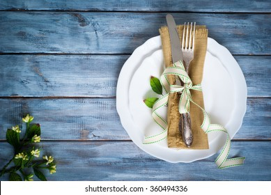 Spring Table setting at wooden table. Top view.