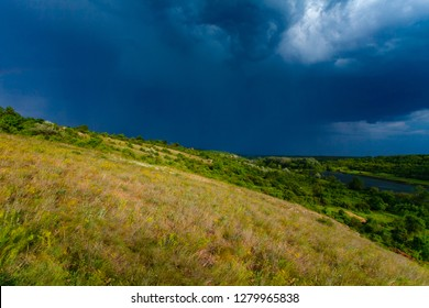 Spring thunderstorm in countryside. Dark blue cloudscape