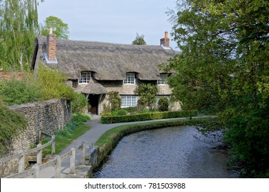 Spring time view of a traditional English Thatched Cottage, in Thornton-Le-Dale, North Yorkshire, England, UK