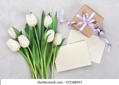 Flower gift stock images royalty free images vectors shutterstock spring tulip flowers gift box and paper card on gray stone table from above in negle Choice Image