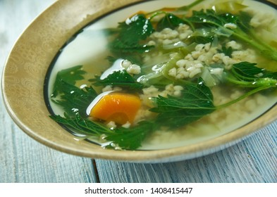 Spring vegetable soup nettle with  Wheat Groats close up