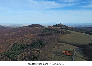 Spring view of the Buchlov castle in the South Moravian region in the Czech Republic and the country behind - aerial photo from ultralight plane