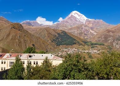 Spring view to the Kazbek mountain and Stepancminda village, Georgia.