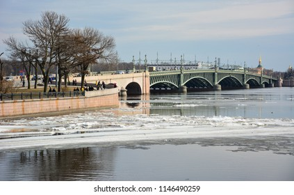 Spring view of the Neva River with the Trinity Bridge, famous for its art nouveau design. Trinity Bridge is a drawbridge in Saint Petersburg, Russia, that is raised every night in summer