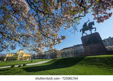 A spring view of one of the most beautiful squares in Zagreb. Art Pavilion in the background and king's statue on the right.
