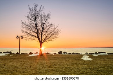 Spring View of Sylvan Beach on Oneida Lake during Sunset while the Lake is Still Frozen.