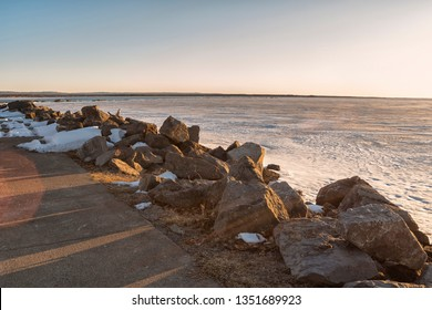 Spring View of Sylvan Beach Shoreline on Oneida Lake during Sunset while the Lake is Still Frozen.