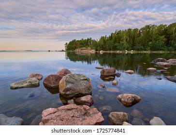 Spring walk along the Gulf of Finland on a wonderful calm morning in Lauttasaari next to the beautiful stones of Finnish nature.