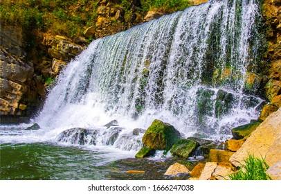 Spring waterfall river rocks view - Shutterstock ID 1666247038