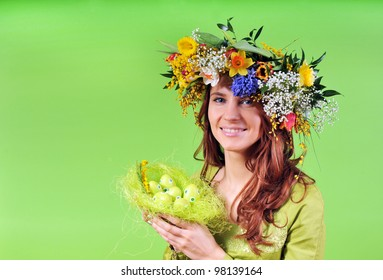 Spring woman with nest