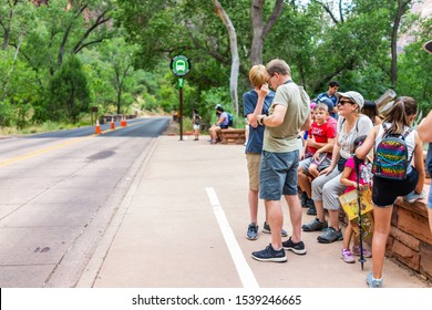Springdale, USA - August 6, 2019: Zion National Park parking lot stop 7 on road in Utah with people waiting in line queue for shuttle bus public transportation in summer