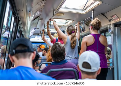 Springdale, USA - August 6, 2019: Zion National Park in Utah inside crowded shuttle bus in summer with many people sitting in chairs or standing