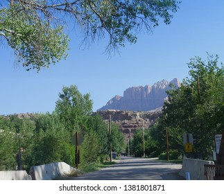 Springdale, Utah--July 2018: Bridge at Springdale road, with the peaks of Zion National Park cliffs in Utah in the background.