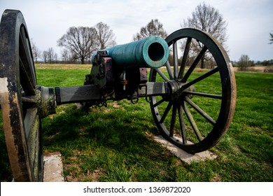 Springfield, MO—April 11, 2019; open muzzle of smoothbore bronze civil war era cannon with wooden wheels and carriage at Wilsons Creek National Battlefield Parkin in Southwest Missouri in Springfield