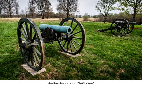 Springfield, MO—April 11, 2019; two civil war era bronze muzzle loaded cannons with wooden carriages and wheels stand in field at Wilsons Creek national Battlefield in Southwest Missouri.