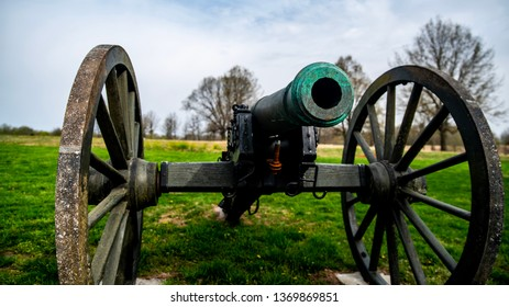 Springfield, MO—April 11, 2019; view into open barrel of bronze civil war era cannon with wooden wheels and carriage at Wilsons Creek National Battlefield park in southwestern Missouri