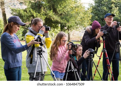 SPRINGFIELD, OR - FEBRUARY 10, 2018: Students in a community program class through Willamalane learn photography from a professional photographer teacher in a park setting outdoors.