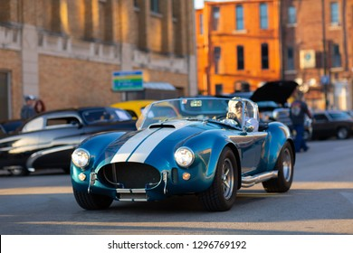 Springfield, Illinois, USA - September 22, 2018: The Route 66 Mother Road Festival, Shelby Cobra sports car being driven on the streets of downtown Springfield