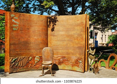Springfield, MA, USA July 14, 2009 An open book and a waiting chair welcome  visitors to the Dr Seuss' Memorial Garden in Springfield, Massachusetts
