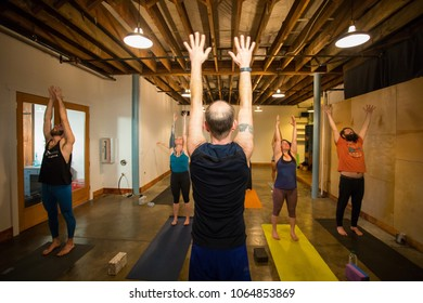 SPRINGFIELD, OR - MARCH 11, 2018: Intermediate stretching class at Common Bond Yoga, an urban yoga startup company located in downtown Springfield.