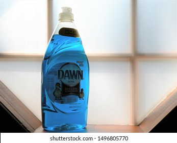 Springfield, MO / USA - September 5 2019. Blue Dawn Dish Soap sitting in Window with natural lighting