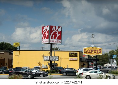 Springfield, MO/USA-Circa October 2018:  Chick-fil-A restaurant with parking lot and pawn shop.