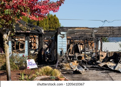 Springfield, OR - October 17, 2018: Badly damage home in Springfield Oregon after a gunman lit three homes on fire and then shot at first responders before taking his life.