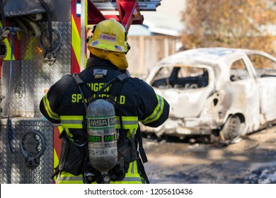 Springfield, OR - October 17, 2018: Firefighter puts on gear before entering a scene in Springfield Oregon where a gunman lit multiple homes on fires and then shot at first responders.