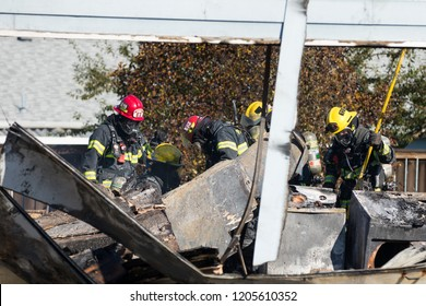 Springfield, OR - October 17, 2018: Firefighters working in Springfield Oregon after a gunman lit three homes on fires and then shot at first responders before taking his own life.