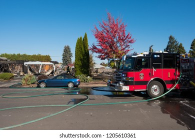 Springfield, OR - October 17, 2018: Springfield firetruck sits motionless in the middle of the road after being shot at from a gunman who lit three homes on fire and then shot at first responders.