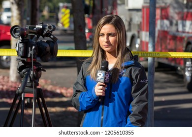 Springfield, OR - October 17, 2018: KEZI News 9 reporter works live on scene after a gunman lit three houses on fire and then shot at first responders.