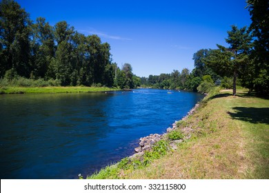 Springfield Oregon's McKenzie River flows on the edge of town slowly with ample opportunity for intertubing recreation.