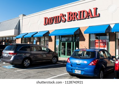 Springfield, USA - January 14, 2018: Storefront of David's Bridal retail store, shop selling wedding dresses, clothes, garment with sign, parked cars, parking lot