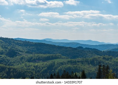 springtime Beskid Slaski, Slezske Beskydy and Moravskoslezske Beskydy mountains with Lysa hora hill in Poland and Czech republic from view tower on Stary Gron above Brenna in Poland