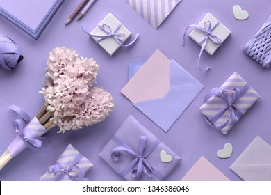Springtime blue  background with pink tulips, hyacinth, wrapped gift boxes and decorative hearts