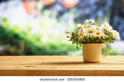 Springtime, Daisies on wooden table, blur nature background, space for text, banner