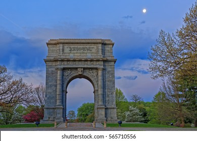 Springtime dawn with the moon shining at Valley Forge National Historical Park in Pennsylvania, USA.The National Memorial Arch is a monument dedicated to George Washington and the United States Army.