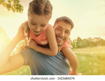 springtime father with daughter in park