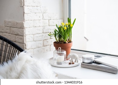 Springtime home decor with yellow daffodils on windowsill