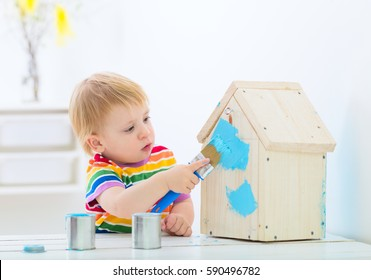 springtime indoors kids activity, toddler baby boy painting new nest house with bright colors
