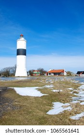 Springtime with melting snow by the Swedish lighthouse at Ottenby on the island Oland in the Baltic Sea