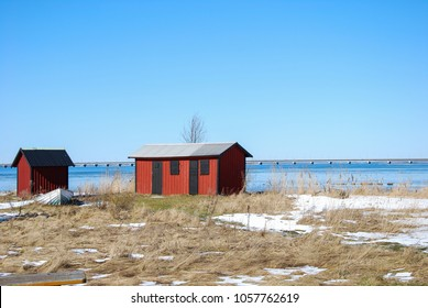 Springtime with red cabins by the coast of the swedish island Oland in the Baltic Sea