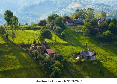 Springtime rural scenery in a traditional Transylvanian hamlet on top of a green hill in Magura village, Brasov county, Romania.