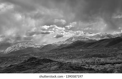 Springtime storm clouds over snow covered mountains near Reno Nevada.