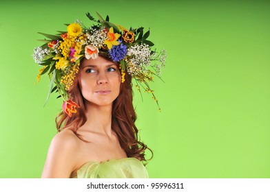 Spring-woman in wreath of flowers