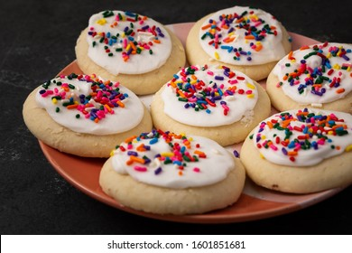 Sprinkle cookies with vanilla icing