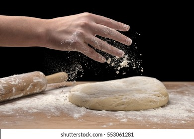 Sprinkling some flour on dough.