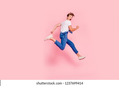 Sprint energy people he him person concept. Side profile full length body size studio photo portrait of handsome delightful charming cool trend swag boy teenager isolated pastel background copyspace