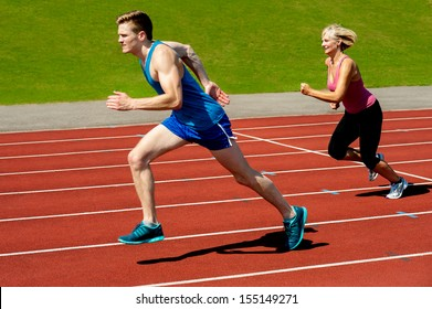 Sprinters racing on the running track
