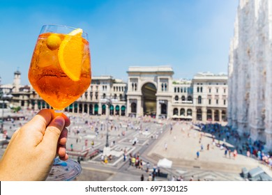 Spritz aperol cocktail drink in Milan overlooking Piazza Duomo in Milan, Italy